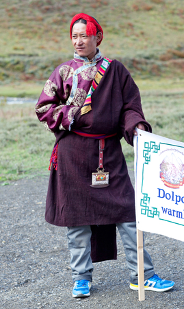 DHO TARAP, DOLPO, NEPAL - SEPTEMBER 11: Nomad man in national clothes waiting for Puja ceremony during Full Moon Festival on September 11, 2011 in Dho Tarap village, Nepal