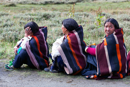DHO TARAP, DOLPO, NEPAL - SEPTEMBER 11: Women in national clothes waiting for Puja ceremony during Full Moon Festival on September 11, 2011 in Dho Tarap village, Nepal