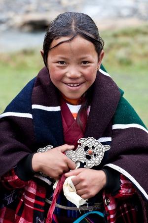 DHO TARAP, NEPAL - SEPTEMBER 11: Tibetan girl poses for the photo during the Dho Tarap Full Moon Festival on September 11, 2011 in Dolpo, Nepal