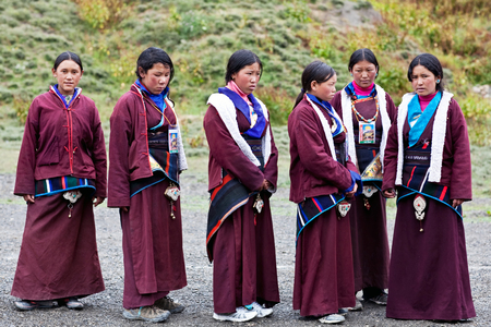 DHO TARAP, DOLPO, NEPAL - SEPTEMBER 11: Girls in national clothes waiting for Puja ceremony during Full Moon Festival on September 11, 2011 in Dho Tarap village, Nepal