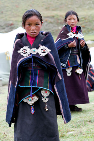 DHO TARAP, DOLPO, NEPAL - SEPTEMBER 11: Girls students of Crystal mountain school in national clothes poses for a photo during Dho Tarap Full Moon Festival on September 11, 2011 in Dho Tarap village, Nepal