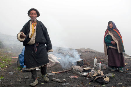 nomads: CHARKA, NEPAL - SEPTEMBER 16: Tibetan nomads at camp waiting for Puja ceremony during Full Moon Festival on September 16, 2011 in Charka Village, Dolpo, Nepal Editorial