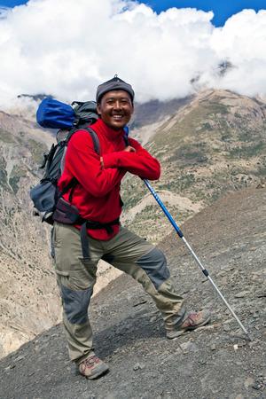 sherpa: UPPER DOLPO, NEPAL - SEPTEMBER 16: Sherpa trekking guide walking tu the pass on September 16, 2011 in Upper Dolpo restricted area, Nepal
