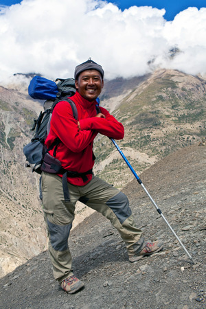 UPPER DOLPO, NEPAL - SEPTEMBER 16: Sherpa trekking guide walking tu the pass on September 16, 2011 in Upper Dolpo restricted area, Nepal