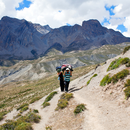 sherpa: Porters with heavy load at the Pass on September 13, 2011 in Upper Dolpo restricted area, Nepal Editorial