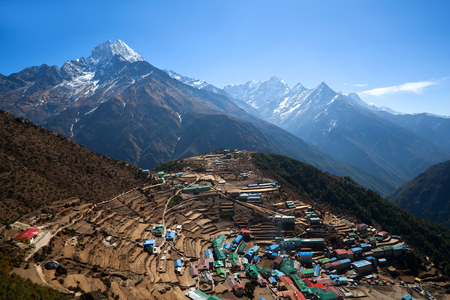 bazar: Namche Bazar view from above in Sagarmatha National park, Nepal. Namche Bazaar is a capital of sherpas - Village Development Committee Namche in Solukhumbu District of north-eastern Nepal