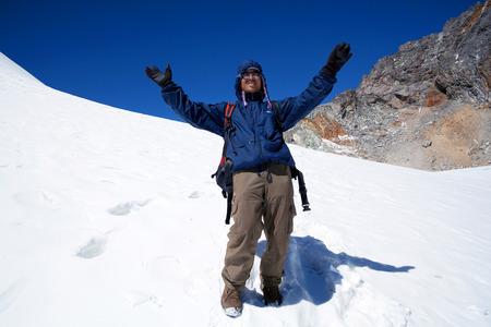 sherpa: Sherpa trekking guide walking across Cho La pass on March 14, 2010 in Sagarmatha National Park, Nepal Himalaya