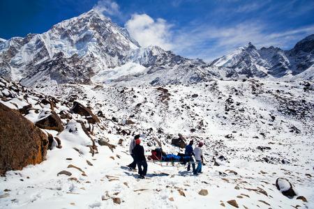 evacuate: Sherpas prepare for emergency evacuate an injured climber on March 16, 2010 in Gorak Shep, Sagarmatha National Park, Nepal