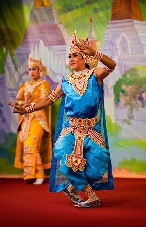 enchantress: YANGON, MYANMAR - JANUARY 25: Burmese dancers performing traditional classical Bagan Dance on January 25, 2011 in Yangon, Myanmar