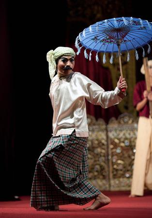 YANGON, MYANMAR - JANUARY 25, 2011: Dancers performing traditional Burmese Jolly Joker Dance of U Shwe Yoe and Daw Moe. Rather than a classic, this dance is an example of contemporary Myanmar folk art.