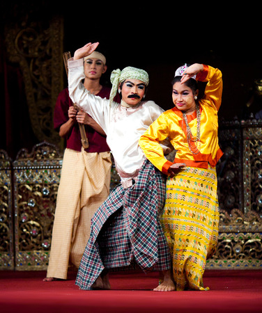 joker: YANGON, MYANMAR - JANUARY 25, 2011: Dancers performing traditional Burmese Jolly Joker Dance of U Shwe Yoe and Daw Moe. Rather than a classic, this dance is an example of contemporary Myanmar folk art.