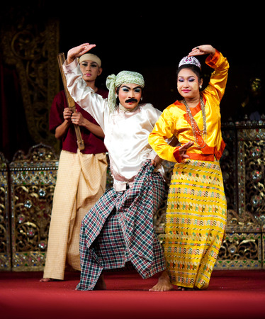 YANGON, MYANMAR - JANUARY 25, 2011: Dancers performing traditional Burmese Jolly Joker Dance of U Shwe Yoe and Daw Moe. Rather than a classic, this dance is an example of contemporary Myanmar folk art.