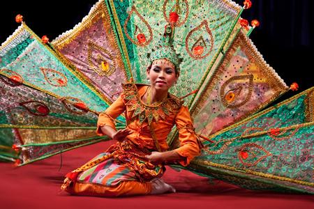 YANGON, MYANMAR - JANUARY 25, 2011: Burmese girl performing traditional Peakock Dance on the evening show in Karaweik Hall. Editorial