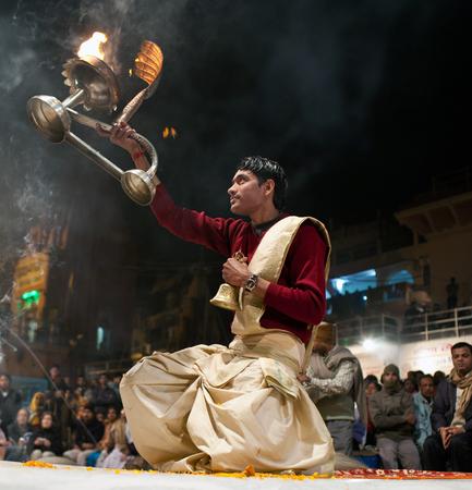 uttar: VARANASI, INDIA - JANUARY 14, 2010: Indian Brahmin conducts religious Ganga Maha Aarti ceremony fire puja at Dashashwamedh Ghat in Varanasi, Uttar Pradesh, India.