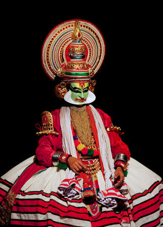 kathakali: VARKALA, INDIA - FEBRUARY 3, 2010: Kathakali actor performing on the evening show in Varkala, Kerala, South India. Kathakali is the ancient classical dance form of Kerala.