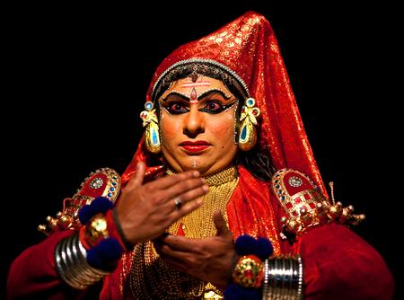 kathakali: VARKALA, INDIA - FEBRUARY 4, 2010: Indian actor performing Kathakali Dance in Varkala Kathakali Center, Kerala, South India. Kathakali is the ancient classical dance form of Kerala. Editorial