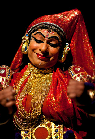 varkala: VARKALA, INDIA - FEBRUARY 4, 2010: Kathakali actor performing on the evening show in Varkala, Kerala, South India. Kathakali is the ancient classical dance form of Kerala.