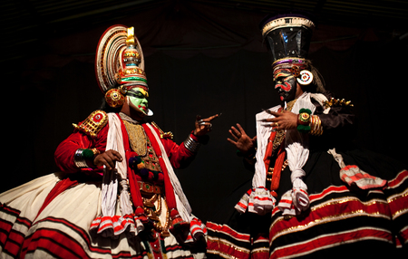 kathakali: VARKALA, INDIA - FEBRUARY 4, 2010: Kathakali actors performing on the evening show in Varkala, Kerala, South India. Kathakali is the ancient classical dance form of Kerala.