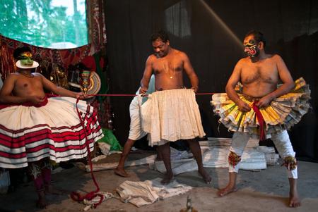 varkala: VARKALA, INDIA - FEBRUARY 10, 2010: Kathakali actor applies make-up before the evening performance in Varkala, India. Kathakali - the classical dance-drama of Kerala based on Indian mythology.