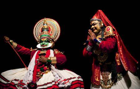 mahabharata: VARKALA, INDIA - FEBRUARY 10, 2010: Kathakali actors performing on the evening show in Varkala, Kerala, South India. Kathakali is the ancient classical dance form of Kerala. Editorial