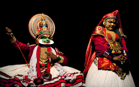 kathakali: VARKALA, INDIA - FEBRUARY 10, 2010: Kathakali actors performing on the evening show in Varkala, Kerala, South India. Kathakali is the ancient classical dance form of Kerala. Editorial