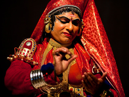 indian classical dance: VARKALA, INDIA - FEBRUARY 4, 2010: Indian actor performing Kathakali Dance in Varkala Kathakali Center, Kerala, South India. Kathakali is the ancient classical dance form of Kerala. Editorial