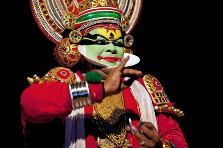 kathakali: VARKALA, INDIA - FEBRUARY 4, 2010: Kathakali actor performing on the evening show in Varkala, Kerala, South India. Kathakali is the ancient classical dance form of Kerala.