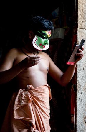 kathakali: VARKALA, INDIA - FEBRUARY 10, 2010: Kathakali actor applies make-up before the evening performance in Varkala, India. Kathakali - the classical dance-drama of Kerala based on Indian mythology.