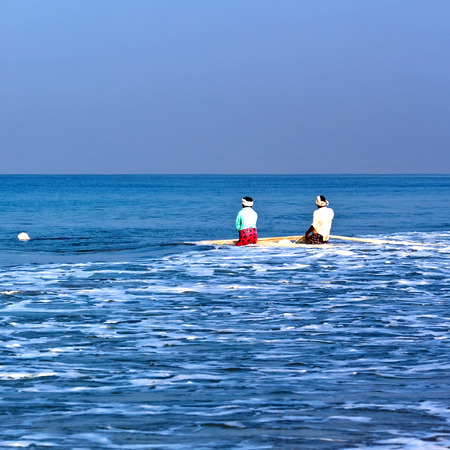 varkala: Two unidentified Indian fishermen with nets catching fish for food in Kerala, South India Stock Photo