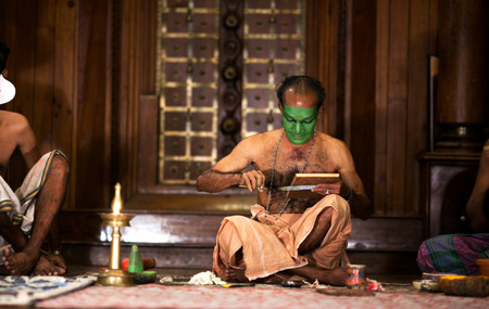 kathakali: FORT COCHIN, INDIA - FEBRUARY 14, 2010: Actor applies make-up before evening Kathakali show in Fort Cochin, South India. Kathakali - the classical dance-drama of Kerala based on Indian mythology, and noted for its elaborate costumes and gestures.
