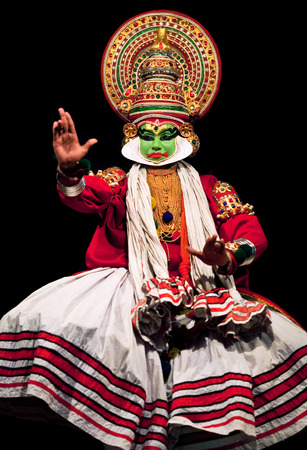 noted: FORT COCHIN, INDIA - FEBRUARY 16, 2010: Actor performing traditional Indian dance-drama Kathakali in in Fort Cochin, South India. Kathakali - the classical dance-drama of Kerala based on Indian mythology, and noted for its elaborate costumes and gestures.