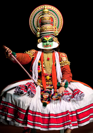 south indian: COCHIN, INDIA - FEBRUARY 17, 2010: Actor performing traditional Indian dance-drama Kathakali in in Fort Cochin, South India. Kathakali - the classical dance-drama of Kerala based on Indian mythology, and noted for its elaborate costumes and gestures