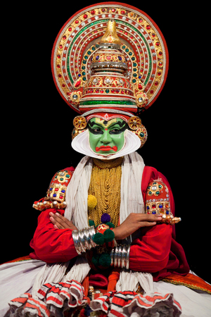 indian classical dance: FORT COCHIN, INDIA - FEBRUARY 16, 2010: Actor performing traditional Indian dance-drama Kathakali in Fort Cochin, South India. Kathakali - the classical dance-drama of Kerala based on Indian mythology, and noted for its elaborate costumes and gestures. Editorial