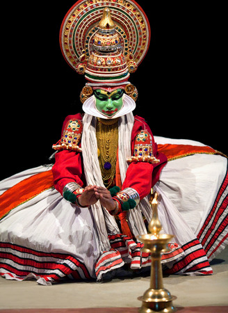 kathakali: FORT COCHIN, INDIA - FEBRUARY 16, 2010: Actor performing traditional Indian dance-drama Kathakali in Fort Cochin, South India. Kathakali - the classical dance-drama of Kerala based on Indian mythology, and noted for its elaborate costumes and gestures. Editorial