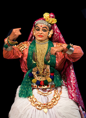 noted: FORT COCHIN, INDIA - FEBRUARY 16, 2010: Actor performing traditional Indian dance-drama Kathakali in Fort Cochin, South India. Kathakali - the classical dance-drama of Kerala based on Indian mythology, and noted for its elaborate costumes and gestures. Editorial