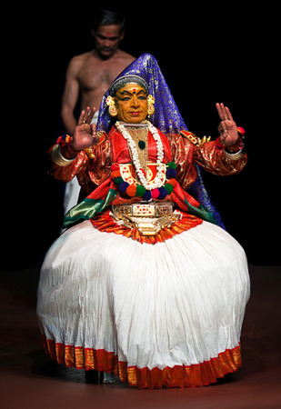 kathakali: FORT COCHIN, INDIA - FEBRUARY 17, 2010: Actor performing traditional Indian dance-drama Kathakali in Fort Cochin, South India. Kathakali - the classical dance-drama of Kerala based on Indian mythology, and noted for its elaborate costumes and gestures.