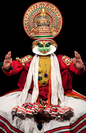 FORT COCHIN, INDIA - FEBRUARY 16, 2010: Actor performing traditional Indian dance-drama Kathakali in in Fort Cochin, South India. Kathakali - the classical dance-drama of Kerala based on Indian mythology, and noted for its elaborate costumes and gestures.