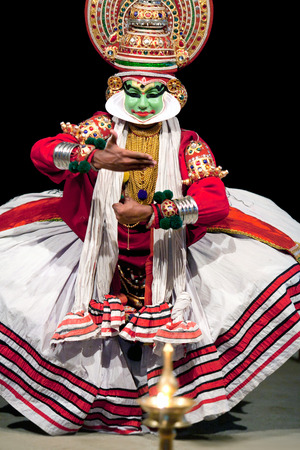 kathakali: COCHIN, INDIA - FEBRUARY 16, 2010: Indian actor performing Kathakali Dance in Fort Cochin, Kerala, South India. Kathakali is the ancient classical dance form of Kerala.