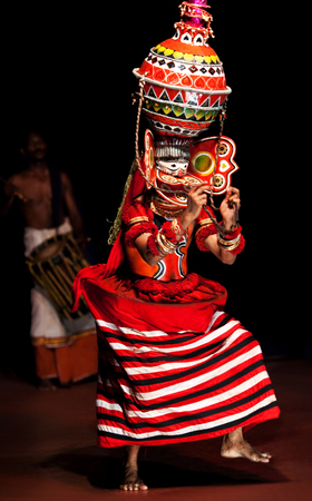 india dance: FORT COCHIN, INDIA - FEBRUARY 17, 2010: Actor performing Theyyam dance in Fort Cochin, South India. Editorial