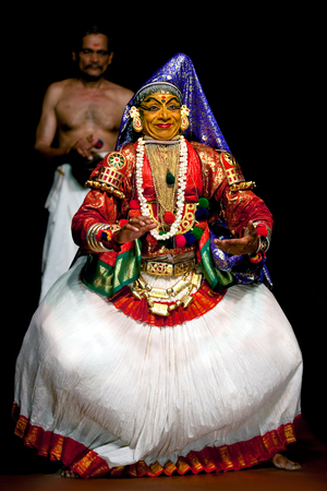 kathakali: FORT COCHIN, INDIA - FEBRUARY 16, 2010: Actor performing traditional Indian dance-drama Kathakali in in Fort Cochin, South India. Kathakali - the classical dance-drama of Kerala based on Indian mythology, and noted for its elaborate costumes and gestures.