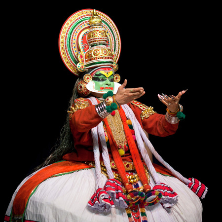 kathakali: COCHIN, INDIA - FEBRUARY 17, 2010: Actor performing traditional Indian dance-drama Kathakali in in Fort Cochin, South India. Kathakali - the classical dance-drama of Kerala based on Indian mythology, and noted for its elaborate costumes and gestures