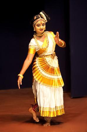 enchantress: COCHIN, INDIA - FEBRUARY 17, 2010: Beautiful Indian girl dancing Mohinyattam Dance of enchantress in Fort Cochin, South India. Mohiniyattam is traditional South Indian dance from Kerala Editorial