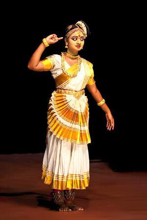 COCHIN, INDIA - FEBRUARY 17, 2010: Beautiful Indian girl dancing Mohinyattam Dance of enchantress in Fort Cochin, South India. Mohiniyattam is traditional South Indian dance from Kerala Editorial