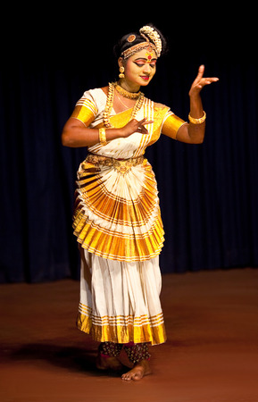 dance music: COCHIN, INDIA - FEBRUARY 17, 2010: Beautiful Indian girl dancing Mohinyattam Dance of enchantress in Fort Cochin, South India. Mohiniyattam is traditional South Indian dance from Kerala Editorial