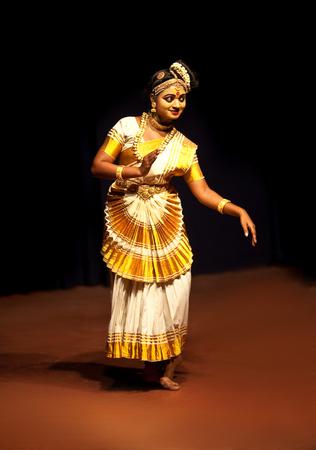 indian classical dance: COCHIN, INDIA - FEBRUARY 17, 2010: Beautiful Indian girl dancing Mohinyattam Dance of enchantress in Fort Cochin, South India. Mohiniyattam is traditional South Indian dance from Kerala Editorial