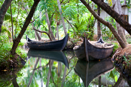 Traditional wooden boat on Kerala backwaters in South India