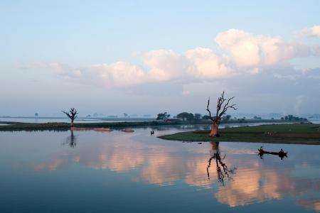 boatman: Burmese men fishing on Thaungthaman Lake on January 12, 2011 in Amarapura, Mandalay Division, Myanmar