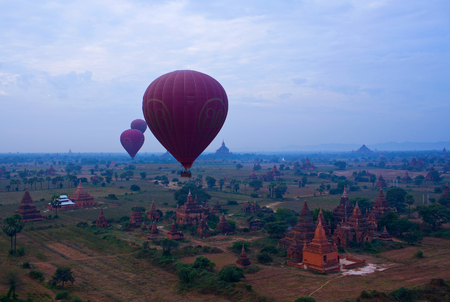 ballooning: Hot air balloon over Bagan, Myanmar. Ballooning over Bagan is one of the most memorable action for tourists. Stock Photo
