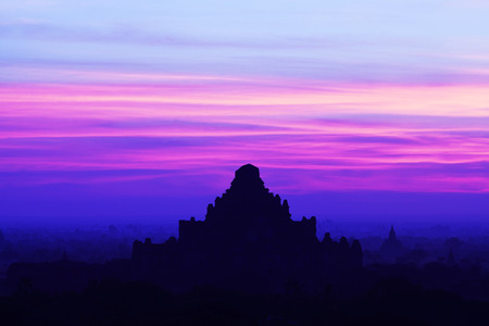 popularly: Silhouette of ancient Dhammayangyi Pahto pagoda at sunset in Bagan Archaeological zone, Myanmar.  Dhammayangyi as it is popularly known was built during the reign of King Narathu 1167-1170. Stock Photo