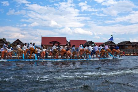 daw: NYAUNG SHWE, MYANMAR - JANUARY 17: Team of Burmese leg rowers crossing the lake during annual Buddhist Phaung Daw U festival on January 17, 2011 on Inle Lake, Shan State, Myanmar.
